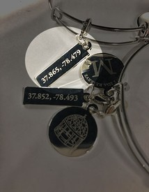 The Lodge Coordinates charm